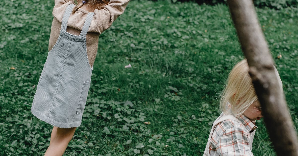 A little girl that is standing in the grass